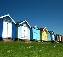Brightly Coloured Beach Huts by Steve Woods