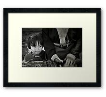 Child at the market Framed Print