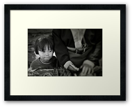 Child at the market by Laurent Hunziker