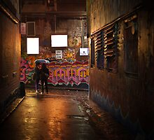 Sharing art and an umbrella in Hosier Lane Melbourne by benthebrown