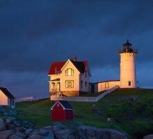 Nubble Lighthouse Sunset by Ron Risman
