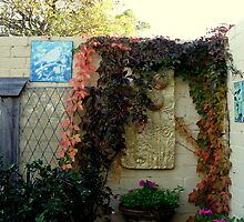 Plaques and baskets in a cottage garden by joycee