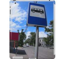 Road sign with a picture of a bus stop on a city street iPad Case/Skin