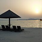 Sunset Flagging on a Dubai Beach by Keith Richardson