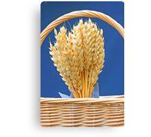 Dried wheat in wicker basket Canvas Print