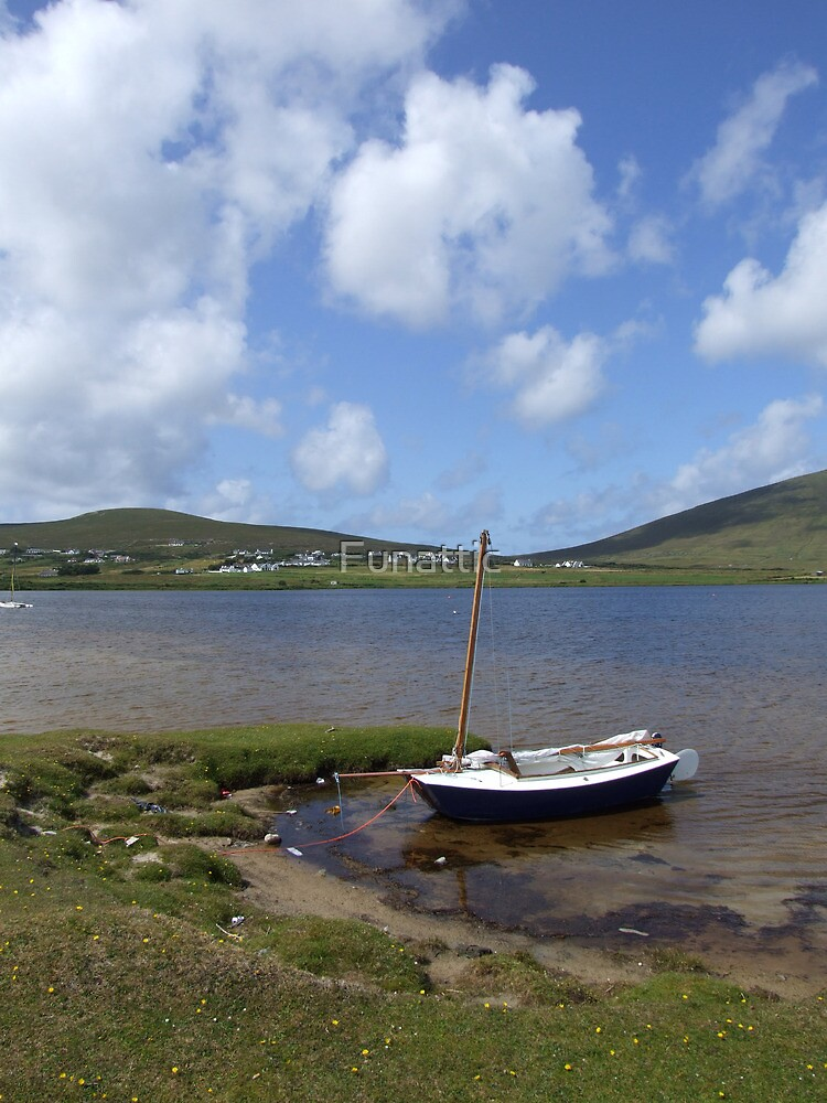 Single docked sailing boat on calm lake in Achill  by Funattic