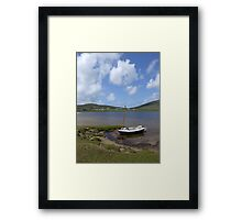 Single docked sailing boat on calm lake in Achill  Framed Print