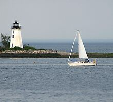 Sailboat and Lighthouse by vvfineartphotog