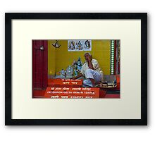 The Priest and The God. Framed Print