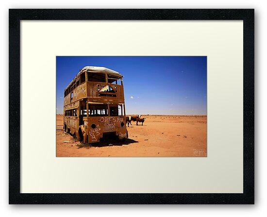 The yellow bus in the Australian desert by Elena Martinello