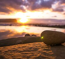 Sunrise with a rock by MitzPicz