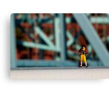 A little photographer on a bridge Canvas Print