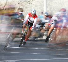 Group of Cyclists Head into the Final Lap by Buckwhite