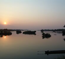 Sun set on Mae Nam Khong River by Feesbay