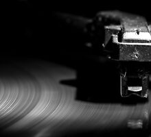 Old style turntable, close-up of a needle by enolabrain