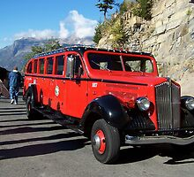 "Red ""jammer"" touring bus by Nancy Richard"