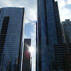 Sun between Chicago Buildings by figuresk8rgirl