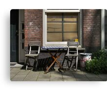 Blue table, bare chairs Canvas Print