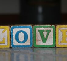 Love in old wooden blocks by Patricia Cleveland
