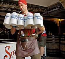Waiter with 12 krugs of beer & shandy, Erlangen Fair, Germany by David A. L. Davies