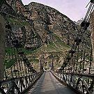mountain bridge. northern india. by tim buckley | bodhiimages