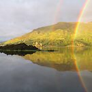 Perfect Rainbow over a loch at Isle of Skye, Scotland by Andy Newham