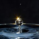 Light flash on water drop by Canbies