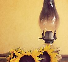 Sunflowers and Oil Lamp by April Koehler