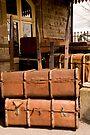 Old luggage at railway station by buttonpresser