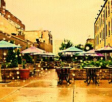 Raindrops on an Outdoor Cafe  by susan stone