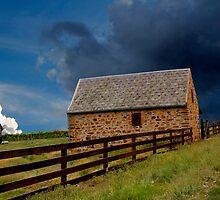 Stormy Rural Landscape by John Wallace