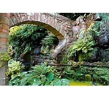 A stone arch decorates the garden Photographic Print