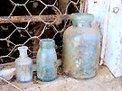 Old bottles on old windowsill. by Julie Sleeman