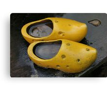 Dutch cheese cloggs in rain Canvas Print