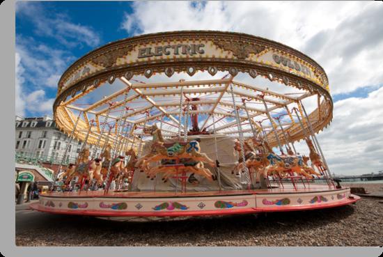 Merry-go-round on Brighton beach by Kevin  Poulton