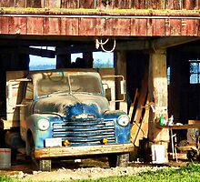 Red Barn Blue Truck by Rick Lawler