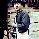 Portrait of a Black Lahu man, Thailand by John Spies