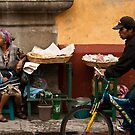 Vendor and Cyclist, Antigua Guatemala by morealtitude