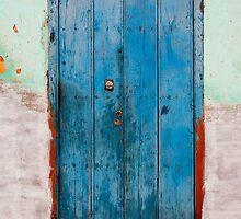 Weather beaten blue door, Trinidad, Cuba by buttonpresser
