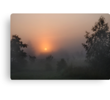 Sunrise in mist Canvas Print