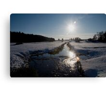Sunset and snow, Warham, Norfolk, UK. Canvas Print
