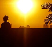 Cool man at sunset in Cartagena Colombia by DFLC Prints