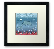Dolphin swimming underwater Framed Print