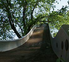Old metal slide in Wakarusa by agenttomcat