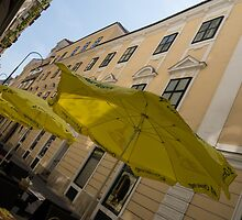 Vienna Street Life - Cheery Yellow Umbrellas at an Outdoor Cafe by Georgia Mizuleva