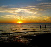 Sunset on the beach by Heather Paakkonen