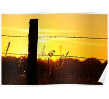 Silhouetted fencepost at sunrise Poster