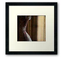 The curtains were heavy as she drew them closed; she remained still and waited Framed Print