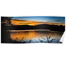 Sunset over a lake Poster