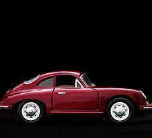 Toy car. Black background. by Josep M Penalver